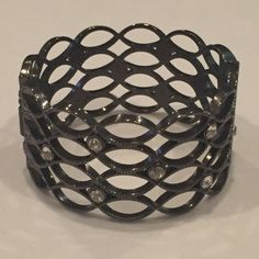 Dark silver hinged bracelet Gorgeous hinged bracelet in dark silver with crystal accents weaved throughout Jewelry Bracelets