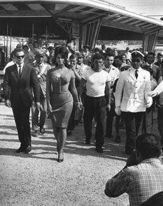 Sophia Loren and an entourage of men