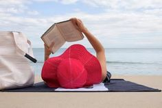 Reading on the beach is a summer must.