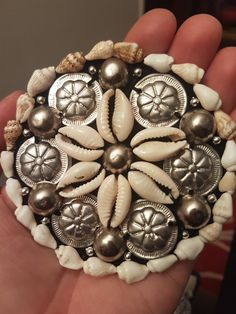 ATS Medallion with cowrie shells and gillet amulets.