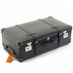 Black globe-trotter suitcase from Pedlars.