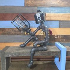 Robot Lamp, Pipe Lamp, Industrial Decor, Steampunk Lighting, Pipe Decor, Man Cave, Junk Style, clever RAVEN, Pipe Lighting, Industrial Lamp by TheCleverRaven on Etsy https://www.etsy.com/listing/271649124/robot-lamp-pipe-lamp-industrial-decor