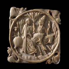 Medieval, approx. AD 1325-75 Paris, France. Ivory mirror case which housed metal mirror depicting a scene of hunting with hawks. Falconry was common in Medieval art and was an expression of courtly love. The scenes on the case were relative to the level of society and the dragons flanking each corner were a common decoration for the period.