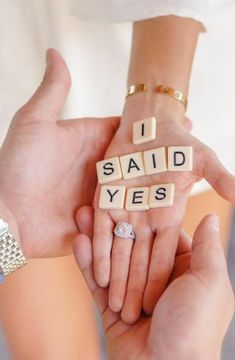 She said yes, and the double halo engagement ring is gorgeous!