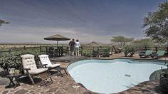The swmming pool area at Serena kirawira has a fascinating view
