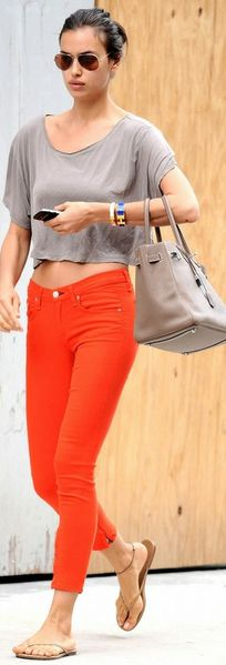 Orange Capri jeans and grey, not in a crop top though.