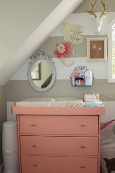 Vintage Coral Changing Table + Funky, Eclectic Gallery Wall