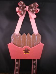 Basket style bow holder with space to hold rubber bands, hair ties, etc.