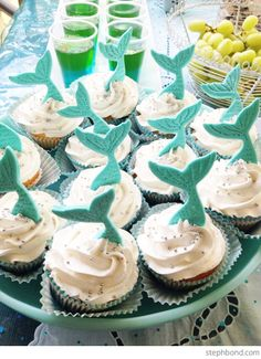 Mermaid cupcakes.  I can make these!  Draw tail design, place under waxpaper and fill in with melted candy melts. Bondville: Eden's 6th Birthday Mermaid Party