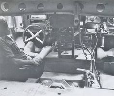 Inside Tiger I tank, driver seated to the left.