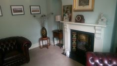 victorian sitting room in farrow and ball Teresa's green fire place in James white