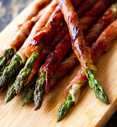Prosciutto Wrapped Asparagus: Choose asparagus spears that are about 3/4-inch thick. Toss lightly in olive oil, salt, and pepper. Cut prosciutto pieces in half, and wrap each spear in a spiral of prosciutto. Grill or broil, about 3 minutes per side, until the prosciutto is crispy. Serve hot, warm, or at room temperature.