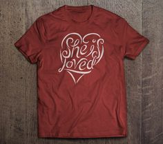 """Veil of Tears Store - She is Loved - T-Shirt  Red, Cotton T-shirt - $20. 100 percent of the money received from this T-shirt will go toward Gospel for Asia's """"Hope for Suffering Women"""" fund."""