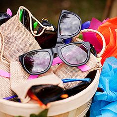 Luau Sunglasses --   Finish off the luau look with a pair of shades for each guest. Set the sunglasses in a basket by the entryway so kids can grab a pair as they walk into the party.