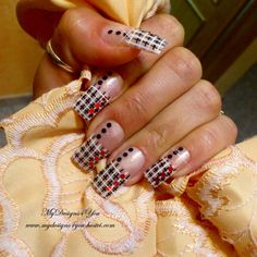 This video tutorial shows how to create plaid French nail art using black and white nail polish colors, and black and red glitter rhinestones. Try this fun nail design today!