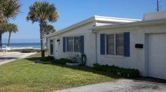 Private Home, Bluebird Beach Cottage- Magnificent Ocean View. Bluebird Cottage, a beachside home with incredible views of the Atlantic Ocean. This 1960's co...