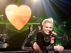 A bedazzled Pink throws down on Wednesday during the opening-night performance of her The Truth About Love world tour at Phoenix's US Airways Center.