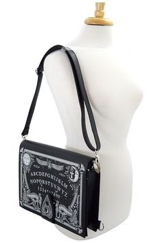 "Limited Edition very unique and rare design "" Ouija Board Bag"" by Restyle. It is a rectangle, structured firm bag made of high quality solid, faux leather. On front, there is huge, detailed print of O"