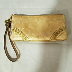 "Coach Gold Studded Wristlet Brand: Coach Item:  Gold withe Sparkling 'C's all over and Brass Hardware Color: Gold Measurements:7""w x 4""h Condition: There is some wear where the studs are, a couple tiny marks on the bag and the inside has a handful of make-up spots.  Please check my other listings for bundles to pay one shipping charge as I have a lot of small things listed. 10% off 4+ bundles YOU make. No lowballs. Coach Bags Clutches & Wristlets"