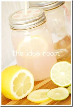 Take a hammer to a screwdriver, aimed at the center of the mason jar lid to create a straw hole. sweet.