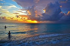 Photographed on Dover Beach, Barbados.  A small boy plays in the waves at sunset as he waits for his Dad to return from canoeing.   Sofa ni dep, Cung cấp sofa ni đẹp tại Hà Nội  http://soloha.vn/sofa-ni-dep.html