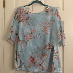 Pretty two-piece spring top This is a very pretty spring top it has a sleeveless tank underneath and a sheer scarf like top over. Excellent condition. Willow Ridge Tops Blouses