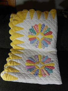 Dresden plate design which came out in 1920s. Fabrics of this cotton quilt are from 1930s and 1940s. 90 in x 70 in.  Awwesome draped in sunny country kitchen or family room!! Love this quilt!!