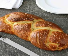 Challah Bread (Braided Egg Bread) for Hanukkah cup plus 2 tbsp milk (I used whole milk) cup plus 1 tsp sugar 2 tsp active dry yeast 4 tbsp unsalted butter, melted and cooled 2 eggs, lightly beaten 4 cups flour 1 tsp kosher salt 1 egg yolk Sesame seeds Challah Bread Recipes, Brioche Bread, Yeast Bread, Savoury Recipes, Cooking Photos, Cooking Tips, Cooking Food, Braided Bread, Bread Rolls