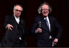 Geoffrey Rush Photos Photos - Australian actor Geoffrey Rush (R) receives the Berlinale Camera award from Berlinale Director Dieter Kosslick from at the 67th Berlinale film festival in Berlin on February 11, 2017. / AFP / Tobias SCHWARZ - Geoffrey Rush Receives the Camera Award at the 67th Berlinale Film Festival