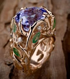 "Cynthia Renee Bespoke Cuprian Tourmaline, rose gold and enamel ""Wisteria"" ring.  Click link for more about the jewel."