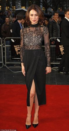 Turning heads: Olga Kurylenko added some much needed glamour to the screening of new flick Snowden in Leicester Square on Saturday