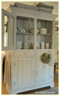 I think this distressed paint look would be good for the linen closet