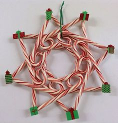 Items similar to Present candy cane wreath on Etsy Items similar to Present cand., Items similar to Present candy cane wreath on Etsy Items similar to Present cand. Christmas Mesh Wreaths, Diy Christmas Ornaments, Christmas Candy, Holiday Crafts, Christmas Parties, Homemade Christmas, Christmas Ideas, Christmas Decorations, Candy Cane Sleigh