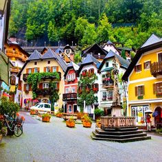 Hallstatt, Austria -------------------------- A UNESCO world heritage site, Hallstatt is usually a popular tourist site. The village seems perched on a small bank of the lake with sheer cliffs behind it and waterfalls streaming down.