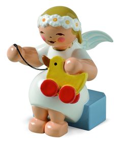 """Marguerite Angel with a Toy Duck - New for 2014.  1-1/2"""" tall with a Wendt and Kühn Presentation / Gift Box. WK no. 634/70/30. Made in the Erzgebirge, Germany. Wendt and Kühn of Grünhainichen, Germany, a """"Toymakers Village""""- since 1915.  Imaginative, unique, elegant, and delicate figurines from a traditional workshop - meticulously hand-crafted by 155 artisans - 80 are painters, but only four (4) paint faces. For more Wendt and Kuehn shop > www.mygrowingtraditions.com"""