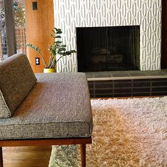 Heath dimensional oval tile fireplace.
