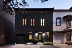 The owners' goal was to transform the 19th-century building into a bold single-family residence. Historical architectural details were made modern with a striking black facade, while inside, a flexible living space that opens into an exterior garden enables a simplified lifestyle.