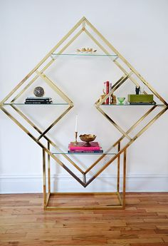 """When Casey stumbled upon this rare brass étagère shelving unit in pristine condition, she pounced on it. Source: Homepolish"""