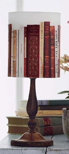Book Spines on a Lampshade ....I think this is a great look and nice idea as long as only damaged books were used for the spines.