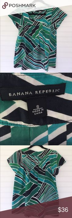 BANANA REPUBLIC Top Certainly a special top.  Beautiful blues/greens and white geometric pattern silk fabric.  Gorgeous pleating on front and back.  Cap sleeves. Squared yoke.  Pit to pit is 17 inches laid flat.  Top is 24 inches long. A beautiful top for a special occasion. Price is firm. No trades.  First come, first served.  Thank you! 😊 Banana Republic Tops Blouses
