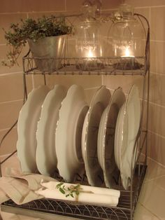 Rustic and romantic plates, lit cloches in dish rack...................so lovely