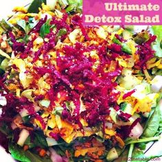 Ultimate Detox Salad - spinach, parsley, basil, red onion, cucumber, raw beet, sesame seeds, shredded cabbage, garlic cloves, fresh ginger, cinnamon, red pepper flakes, lemon