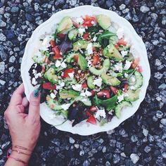 Just salad. It's so easy. Take some lettuce, cucumber, tomatoes. A base so you will stay full until snack time, like quinoa, beans, lentils, pasta or like I had: wheat berries. Avocado. Maybe some cheese. Seeds and herbs (I used sunflower seeds and chives). Sprinkle with olive oil and lemon.