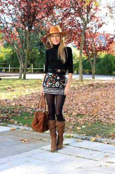 Boho fashion fall outfit that is simply gorgeous! We love the patterned mini skirt and boots!