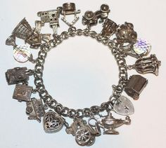 Bracelet filled with charms that either move and/or open...what a FUN bracelet to own!!!  Some of these charms are Nuvo....all are vintage.
