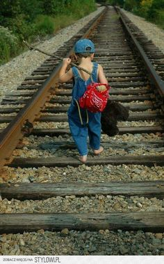 Homeless child on railroad tracks. Thats one safe kid
