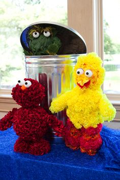Elmo, Big Bird and Oscar the Grouch made of flowers and leaves