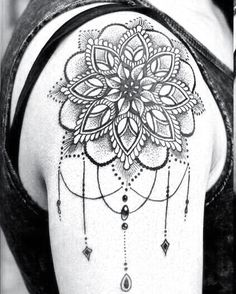 mandala tattoo with dot work and hanging