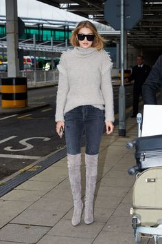 Arriving+at+London's+Heathrow+Airport+in+a+gray+turtleneck,+jeans+and+suede+over-the-knee+boots.+   - HarpersBAZAAR.com