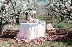 sweetheart table among the blossom